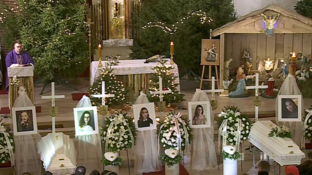 Five teenage girls killed in a fire at an 'escape room' attraction were laid to rest in a joint funeral in their home city of Koszalin